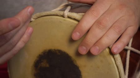 tambourine : Close up of hands of a man playing a drum. Slow Motion. Stock Footage