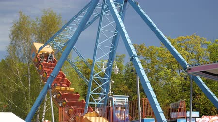 карусель : Attractions in the park and entertainment for adults and children.Extreme and emotional entertainment for swinging and spinning rides in the big boat. Kaliningrad - May 2018 Russian