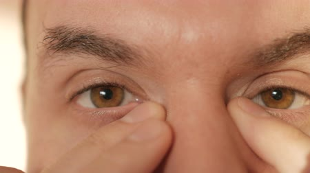 перегружены : Middle-aged man rubs tired eyes with his hands. Closeup.