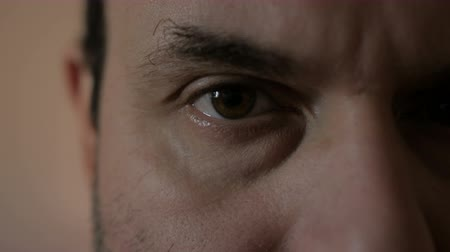 heyecan verici : The man is looking at the camera. Close-up. The eyes of man. Stok Video