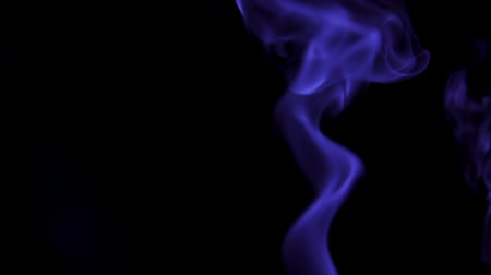 dumanlı : Blue Steam Rises from up. Blue smoke over a black background. Smoke slowly floating through space against black background. Slow Motion. Stok Video