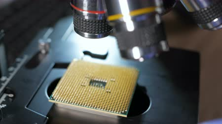 полупроводник : Processor is being examined for visible defects under microscope. In Modern Electronic Manufacturing Design Engineer Holds Microchip. Close-up a New Generation Microchip. CPU closeup. Стоковые видеозаписи