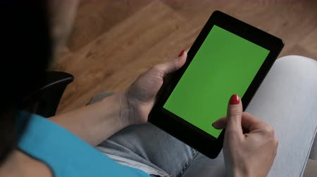 přenosný : Girl using digital tablet. Hand holding green screen with white screen on white background. Technology. Dostupné videozáznamy