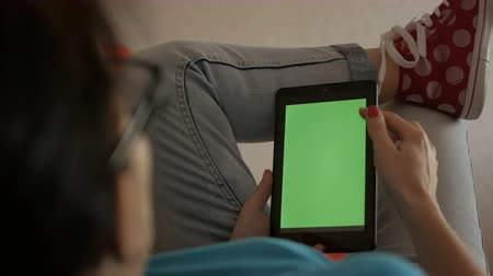manikür : Girl using digital tablet. Hand holding green screen with white screen on white background. Technology. Stok Video