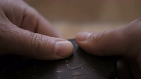 cukros : Man breaks chocolate bar. Slow motion. Close up. Hands break a bar of chocolate. Closeup. Stock mozgókép