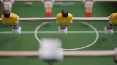 ロジック : Friends Playing Table Soccer Game Closeup. People playing football or kicker with miniature players. Slow Motion. Shallow DOF. Playing Football Soccer on game table. Close Up.