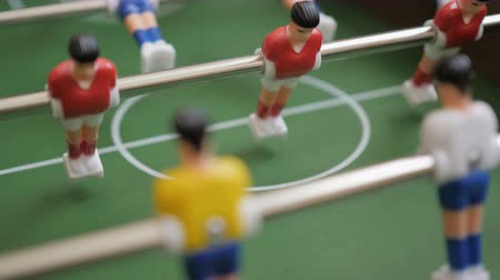 вратарь : Friends Playing Table Soccer Game Closeup. People playing football or kicker with miniature players. Slow Motion. Shallow DOF. Playing Football Soccer on game table. Close Up.