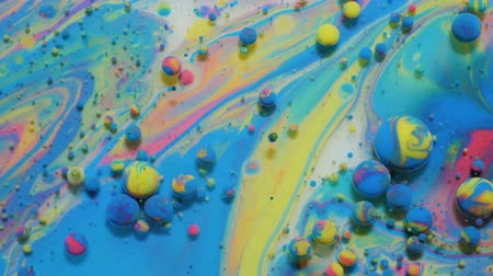 重力 : Slow Motion Bright Colors Bubbles Oil Beautiful Paint Universe Color Moving Multicolored Closeup. Acrylic Paint. Fantastic Hypnotic Surface. Abstract Colorful Paint Metamorphosis Structure Colorful Bu