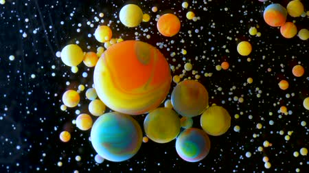 neutron : Slow Motion Bright Colors Bubbles Oil Beautiful Paint Universe Color Moving Multicolored Close Up. Acrylic Paint. Fantastic Hypnotic Surface. Abstract Colorful Paint Metamorphosis Structure Bubbles Stock Footage
