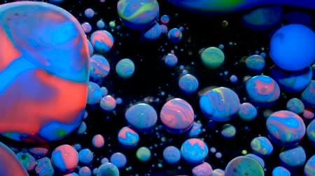 gravitace : Colorful Bubbles Oil Beautiful Paint Universe Color Moving Multicolored. Acrylic Paint. Fantastic Hypnotic Surface. Metamorphosis Multicolored Bubbles Of Bright Colors Moving In Paint Oil Surface.