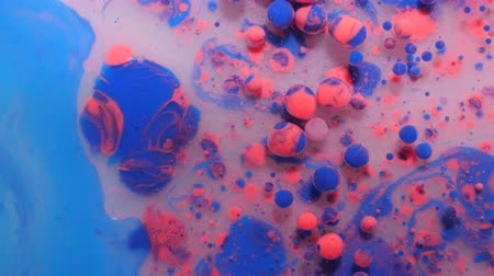 gravitace : Slow Motion Bright Colors Blue and Pink Bubbles Oil Beautiful Paint Universe Color Moving Multicolored. Acrylic Paint. Fantastic Hypnotic Surface. Abstract Colorful Paint Metamorphosis Structure.