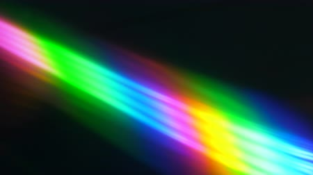 lom světla : Colorful Light Beam and Ray on Black Background. Abstract Background Rainbow on CD. Beautiful Color Lens Light Rainbow Beam for Movie and Cinema at Night. Prism Separating Ray Into Colors of Spectrum.
