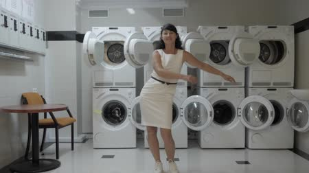 crazy girl : Woman Dancing Viral Dance And Have Fun In the Laundry Room. Happy Business Woman Enjoying Dance, Having Fun Together, Party. Joyful Female in Formal Dress Dancing Cheerful In Laundry Room. Stock Footage