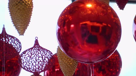 önemsiz şey : Christmas and New Year Decoration. Christmas Big Red Balls on Background of Luminous Lanterns and Gold Garlands. Holiday Background. Blinking Garland Red baubles With Lights Twinkling Close up.