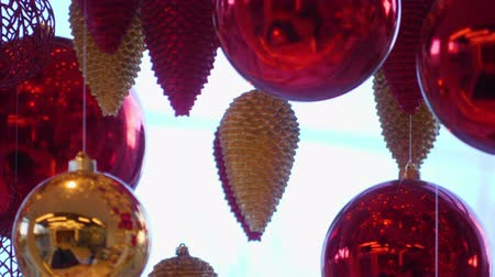 christmas ball gold : Christmas and New Year Decoration. Christmas Big Red Balls on Background of Luminous Lanterns and Gold Garlands. Holiday Background. Blinking Garland Red baubles With Lights Twinkling Close up.