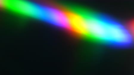 pryzmat : Colorful Light Beam and Ray on Black Background. Abstract Background Rainbow on CD. Beautiful Color Lens Light Rainbow Beam for Movie and Cinema at Night. Prism Separating Ray Into Colors of Spectrum.