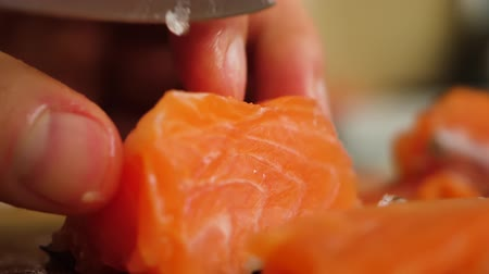 刺身 : Healthy Eating Sea Food Omega. Man Cutting Red Fish Salmon On Wooden Board Close Up. Chef Cuts Redfish, Most Delicious Meat Slow Motion. Macro Chef Cuts Salmon Fillet Slices For Cooking Sushi Closeup.
