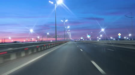 ponto de referência : Driving Car POV On Freeway In Of Night In With Little Traffic After Sunset. Evening Sunset Street Lights. Night, Camera In Front, Windshield Reference. Driving Car On Highway At Dark 4K POV.