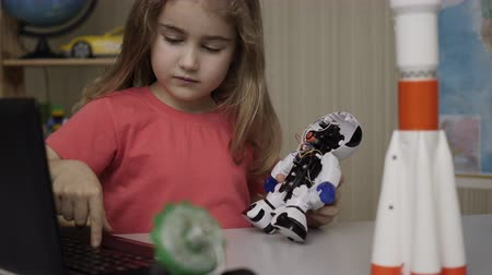 Hobby Future. Genius Schoolgirl Assembling Robots in Modern Classroom. Little Girl Assemble Robot at Home. Education Science, Technology Children, Programming Electronic Robotics School Lesson.