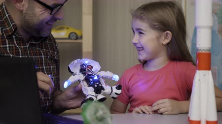 Girl Schoolgirl And Teacher Assembling Robots in Modern Classroom. Dad and Daughter Assemble Robot at Home. Education Science, Technology Children, Programming Electronic Robotics School Lesson. Stockvideo