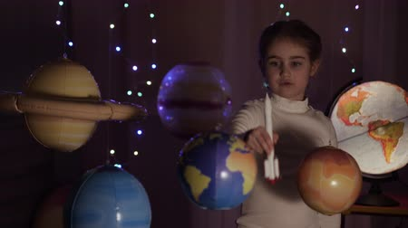 álmodozó : Space Travel Game Inspiration Spaceship. Little Kid Girl Astronaut Launching Toy Rocket From Spaceport Through Planets. Child Dreamer Playing With Toy Space Rocket Flying Among Planets. SLOW MOTION.