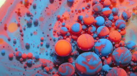 gravitace : Slow Motion Bright Neon Color Bubbles Oil Beautiful Fluorescent Paint Sparkling Color Moving Multicolor Close up. Acrylic Neon Paint. Fantastic Surface. Abstract Colorful Transformation Gravitation.