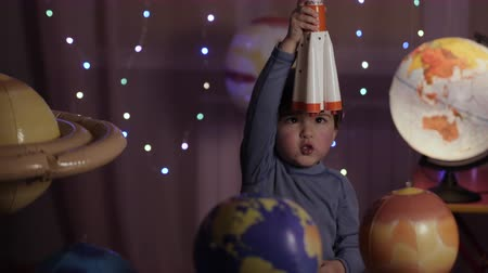 rockets : Space Travel Game Inspiration Spaceship. Little Kid Boy Astronaut Launching Toy Rocket From Spaceport Through Planets. Child Dreamer Playing With Toy Space Rocket Flying Among Planets. SLOW MOTION. Stock Footage