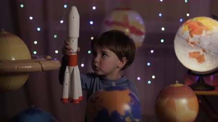 Space Travel Game Inspiration Spaceship. Little Kid Boy Astronaut Launching Toy Rocket From Spaceport Through Planets. Child Dreamer Playing With Toy Space Rocket Flying Among Planets. SLOW MOTION. Dostupné videozáznamy