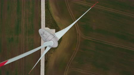 perennite : Spinning Wind Turbines On Beautiful Sunset Autumn Landscape. Green Ecological Power Energy Generation. Wind Turbines Farm Eco Field. Sunrise Above Windmills On Field. Aerial View. Energy Production.