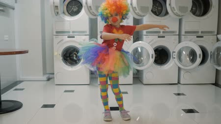 Happy Clown Little Girl Dancing And Have Fun In the Laundry Room. Little Child Clown Enjoying Dance, Having Fun Together, Party. Floss Dance Viral, Flossing.