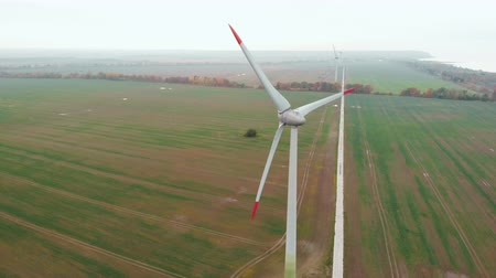 Spinning Wind Turbines On Beautiful Sunset Autumn Landscape. Green Ecological Power Energy Generation. Wind Turbines Farm Eco Field. Sunrise Above Windmills On Field. Aerial View. Energy Production.