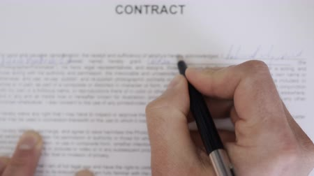 Close up Shot of Businessman. Man Signing Credit Bank Contract. Legal Agreement. Filling out Contract on Paper Closeup.