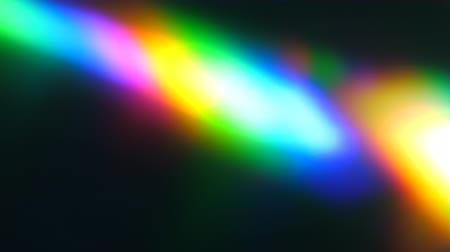 Colorful Light Beam and Ray on Black Background. Abstract Background Rainbow on CD. Beautiful Color Lens Light Rainbow Beam for Movie and Cinema at Night. Prism Separating Ray Into Colors of Spectrum.