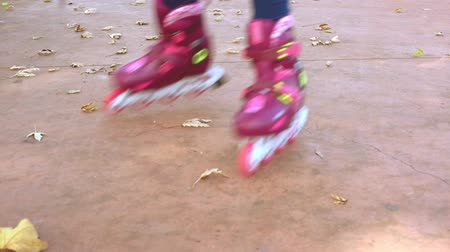 inline : Kids legs in inline skates. Slow motion Stock Footage