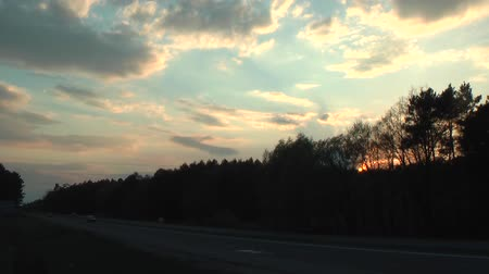 settings : Sunset over the highway