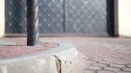 briquettes : pavement,paving stone,curb stone,wrought iron gate Stock Footage