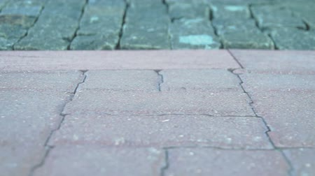 gyalogút : The camera on the slider removes the paving slabs on the promenade, HD Stock mozgókép