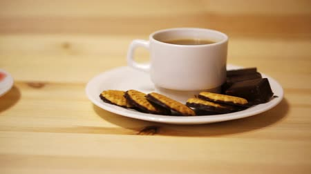 nibble : Tea with cookies on wooden background