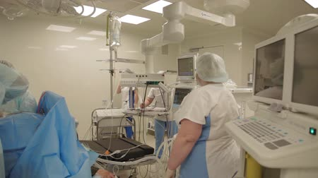 general electric : during an operation in a hospital Stock Footage