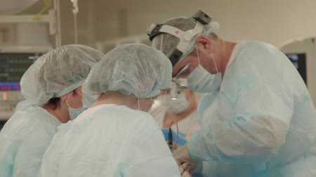 general electric : surgeon at work in hospital