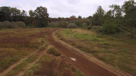 bisikletçi : Aerial view of motocross dirt track drone following motocross riders off-road 4k Stok Video