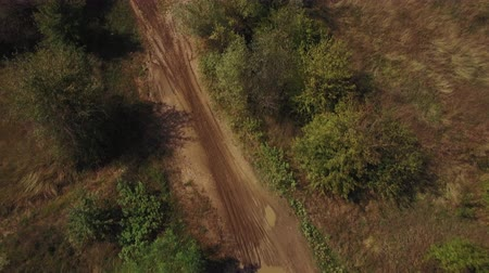 bikers : Aerial view of motocross dirt track drone following motocross riders off-road 4k Stock Footage
