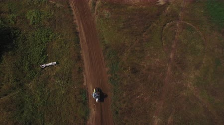 pista de corridas : Aerial view of motocross dirt track drone following motocross riders off-road 4k Stock Footage