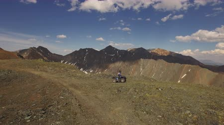 mono lake : Aerial view 4x4 ATV driving off road to top of mountain peak Altai 4k Stock Footage