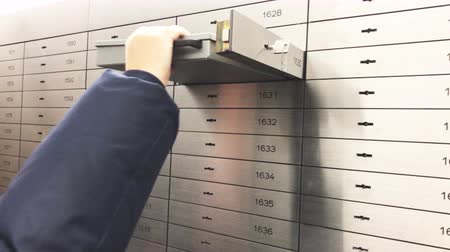 безопасный : Safe deposit box open in a sure safe deposit cell