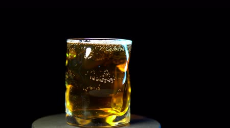 frothy : Cold beer in a glass rotation 360 degrees on black background, of alcohol seamless looping shot.