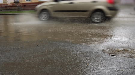 plash : Water from heavy rain. Splash by cars when they pass through a large puddle near a storm sewer.