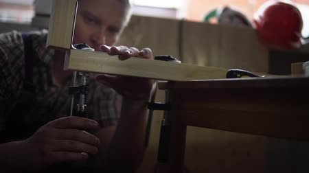 cabinetry : Process of building a wooden table.