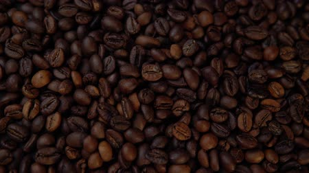 dark roast : Dark roasted beans rotate counter-clockwise, top view of the coffee background.