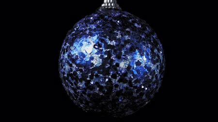 bombki : Close-up shot of blue ball rotates clockwise on black background, Christmas and New Year decoration isolated on dark, seamless looping.
